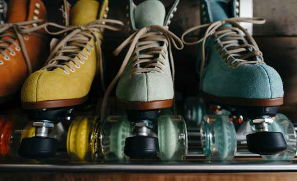four unpaired assorted color roller blades